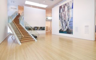 Wooden stairs with glass balustrades by Top Flyte